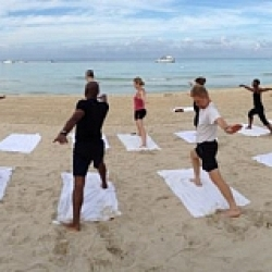 Panoramic of yoga on the beach