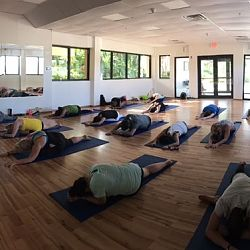 Special early evening class of yin yoga offered to a group of travel agents. SERVICE!